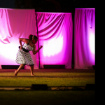 Two dancers in dresses on grass for Arts Under The Stars 2012